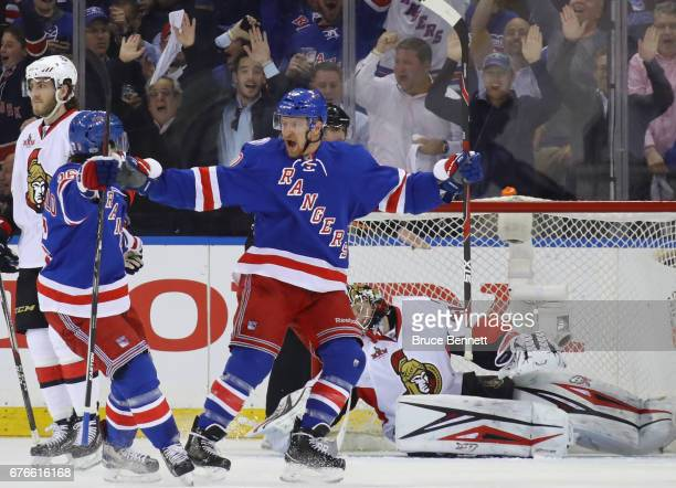 Michael Grabner of the New York Rangers celebrates his first period goal against Craig Anderson of the Ottawa Senators and is joined by Mats...