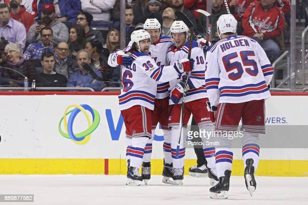 Michael Grabner of the New York Rangers celebrates with teammates after scoring a goal against the Washington Capitals during the second period at...