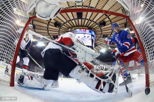 Michael Grabner of the New York Rangers watches a first period shot by Nick Holden go past Craig Anderson of the Ottawa Senators in Game Four of the...