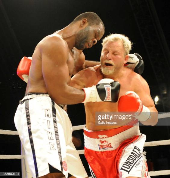 Michael Grant and Francois Botha exchange blows during the World Boxing Federation Heavyweight title bout at Monte Casino on November 19 2011 in...