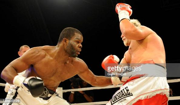 Michael Grant hits Francois Botha during the World Boxing Federation Heavyweight title bout at Monte Casino on November 19 2011 in Johannesburg South...