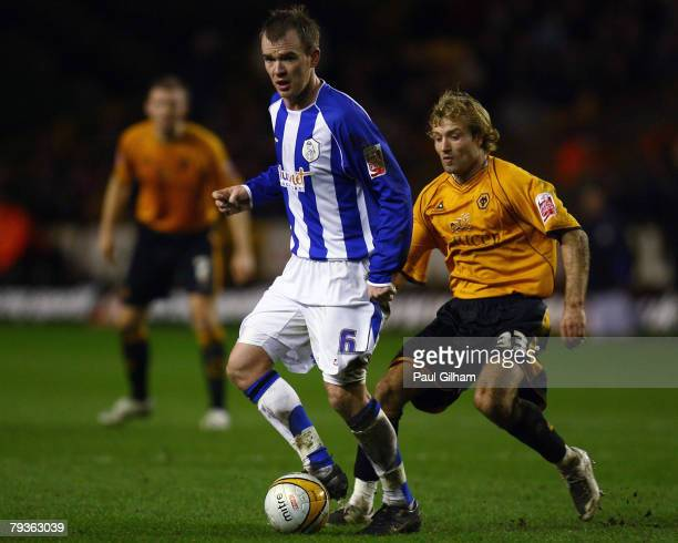 Michael Gray of Wolverhampton Wanderers battles for the ball with Glenn Whelan of Sheffield Wednesday during the CocaCola Championship match between...