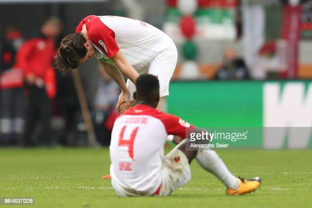 Michael Gregoritsch of Augsburg and Daniel Opare of Augsburg dejected after the Bundesliga match between FC Augsburg and Hannover 96 at WWKArena on...