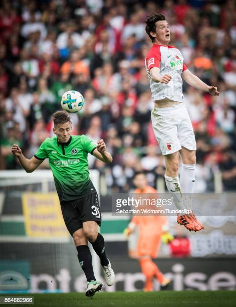 Michael Gregoritsch of Augsburg and Waldemar Anton of Hannover 96 jump for a header during the Bundesliga match between FC Augsburg and Hannover 96...