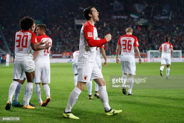 Michael Gregoritsch of Augsburg celebrates after he scored his teams first goal to make it 10 during the Bundesliga match between FC Augsburg and RB...