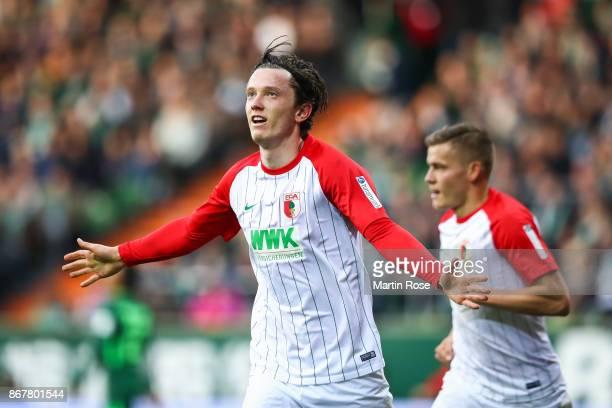 Michael Gregoritsch of Augsburg celebrates after scoring his team's first goal to make it 01 during the Bundesliga match between SV Werder Bremen and...