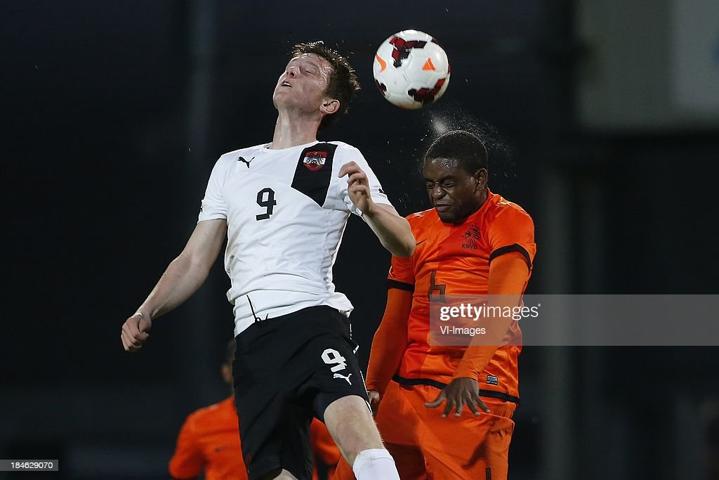 Michael Gregoritsch of Austria U21, Kyle Ebecilio of Netherlands U21 during 2015 UEFA European U21 Championships Qualifier match between the Netherlands U21 and Austria U21 at the Adelaarshorst on Oktober 14, 2013 in Deventer, The Netherlands