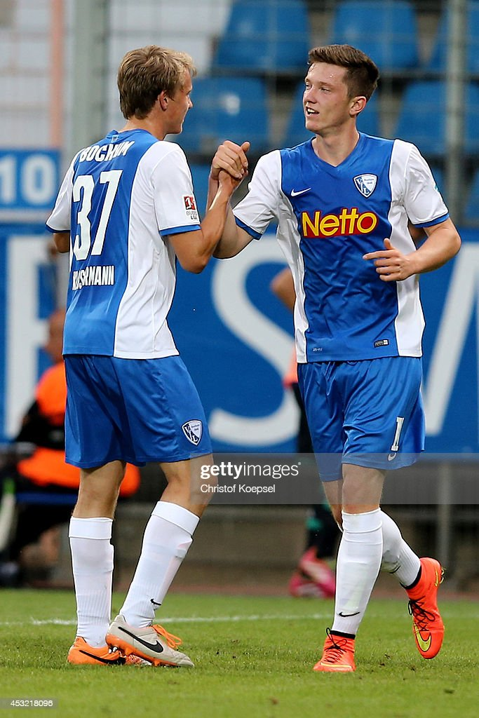 Michael Gregoritsch of Bochum (R) celebrates the first goal with Lukas Klostermann of Bochum (L) during the pre-season friendly match between VfL Bochum and FC Schalke 04 at Rewirpower Stadium on August 5, 2014 in Bochum, Germany.