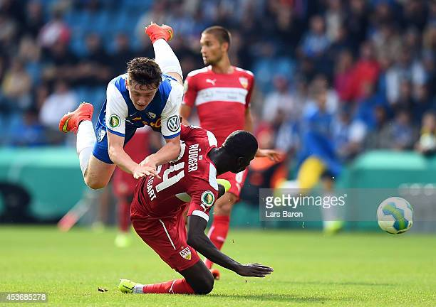 Michael Gregoritsch of Bochum is challenged by Antonio Ruediger of Stuttgart during the DFB Cup first round match between VfL Bochum and VfB...
