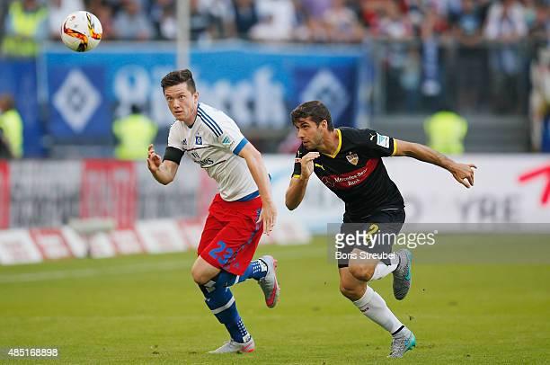 Michael Gregoritsch of Hamburg and Emiliano Insua of Stuttgart battle for the ball during the Bundesliga match between Hamburger SV and VfB Stuttgart...