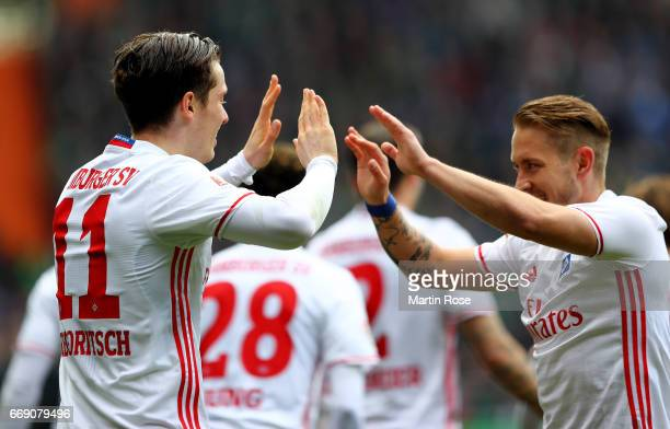 Michael Gregoritsch of Hamburg celebrate with team mate Lewis Holtby after scoring the opening goal during the Bundesliga match between Werder Bremen...