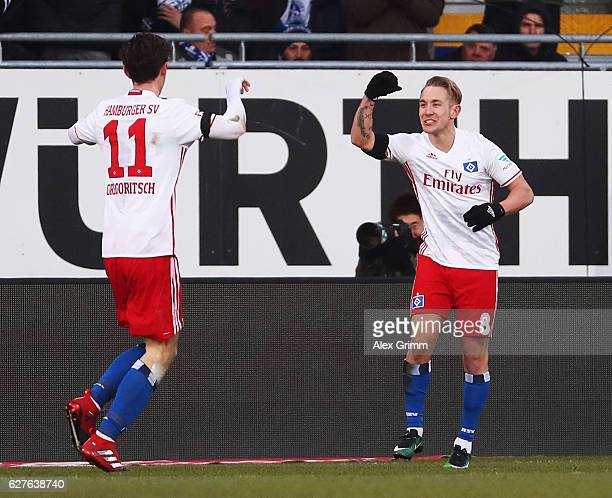 Michael Gregoritsch of Hamburg celebrates scoring his goal with Lewis Holtby during the Bundesliga match between SV Darmstadt 98 and Hamburger SV at...