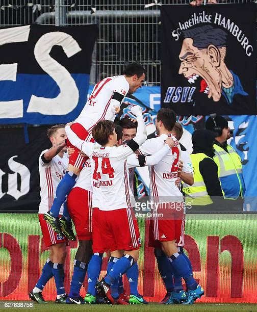 Michael Gregoritsch of Hamburg celebrates scoring his goal with teamates during the Bundesliga match between SV Darmstadt 98 and Hamburger SV at...
