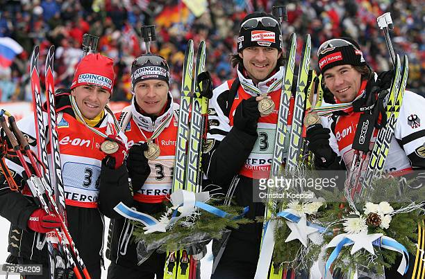 Michael Greis Andreas Birnbacher Alexander Wolf and Michael Roesch of Germany show their bronze medal after the Mens 4 x 75 km relay of the IBU...
