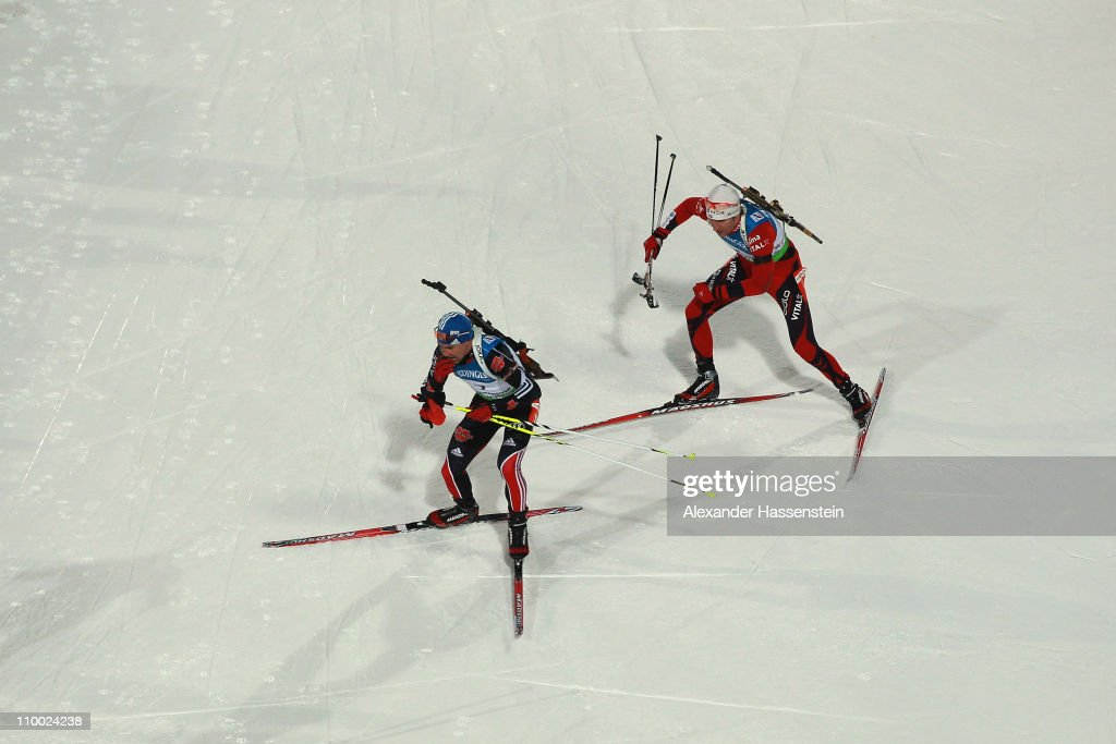 Michael Greis (L) of Germany and Emil Hegle Svendsen (R) of Norway compete in men's mass start during the IBU Biathlon World Championships at A.V. Philipenko winter sports centre on March 12, 2011 in Khanty-Mansiysk, Russia.