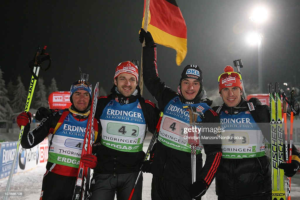 Michael Greis of Germany celebrates the team victory with Alexander Wolf Christoph Stephan and Arnd Peiffer after the men's relay during the eon IBU...