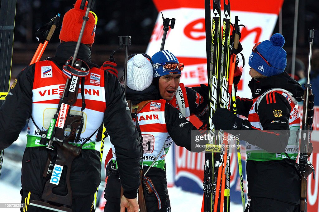 Michael Greis of Germany celebrates winning the silver medal at the mixed relay with his team mates Magdalene Neuner Andrea Henkel and Arnd Pfeiffer...