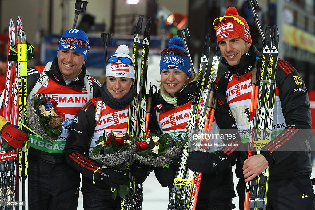 <a gi-track='captionPersonalityLinkClicked' href=/galleries/search?phrase=Michael+Greis&family=editorial&specificpeople=702831 ng-click='$event.stopPropagation()'>Michael Greis</a> (L) of Germany celebrates winning the silver medal at the mixed relay with his team mates <a gi-track='captionPersonalityLinkClicked' href=/galleries/search?phrase=Andrea+Henkel&family=editorial&specificpeople=233764 ng-click='$event.stopPropagation()'>Andrea Henkel</a> (2nd L), <a gi-track='captionPersonalityLinkClicked' href=/galleries/search?phrase=Magdalena+Neuner&family=editorial&specificpeople=2095093 ng-click='$event.stopPropagation()'>Magdalena Neuner</a> (2nd R) and Arnd Pfeiffer (R) at the flower ceremony during the IBU Biathlon World Championships at A.V. Philipenko winter sports centre on March 3, 2011 in Khanty-Mansiysk, Russia.
