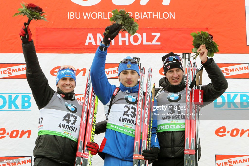 <a gi-track='captionPersonalityLinkClicked' href=/galleries/search?phrase=Michael+Greis&family=editorial&specificpeople=702831 ng-click='$event.stopPropagation()'>Michael Greis</a> (second) of Germany celebrates with Anton Shipulin (winner) of Russia and <a gi-track='captionPersonalityLinkClicked' href=/galleries/search?phrase=Lars+Berger&family=editorial&specificpeople=802043 ng-click='$event.stopPropagation()'>Lars Berger</a> (third) of Norway after the men's sprint during the E.ON IBU Biathlon World Cup on January 20, 2011 in Antholz-Anterselva, Italy.