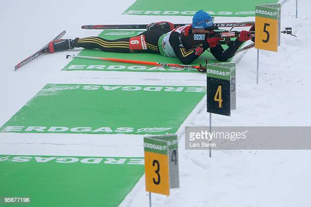 Michael Greis of Germany is seen at the shooting range during the Men's 15 km mass start in the eon Ruhrgas IBU Biathlon World Cup on January 10 2010...