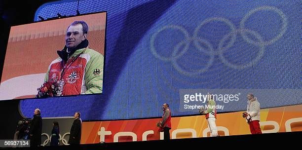Michael Greis of Germany receives the Gold medal withTomasz Sikora of Poland receives the Silver medal and Ole Einar Bjoerndalen of Norway receives...