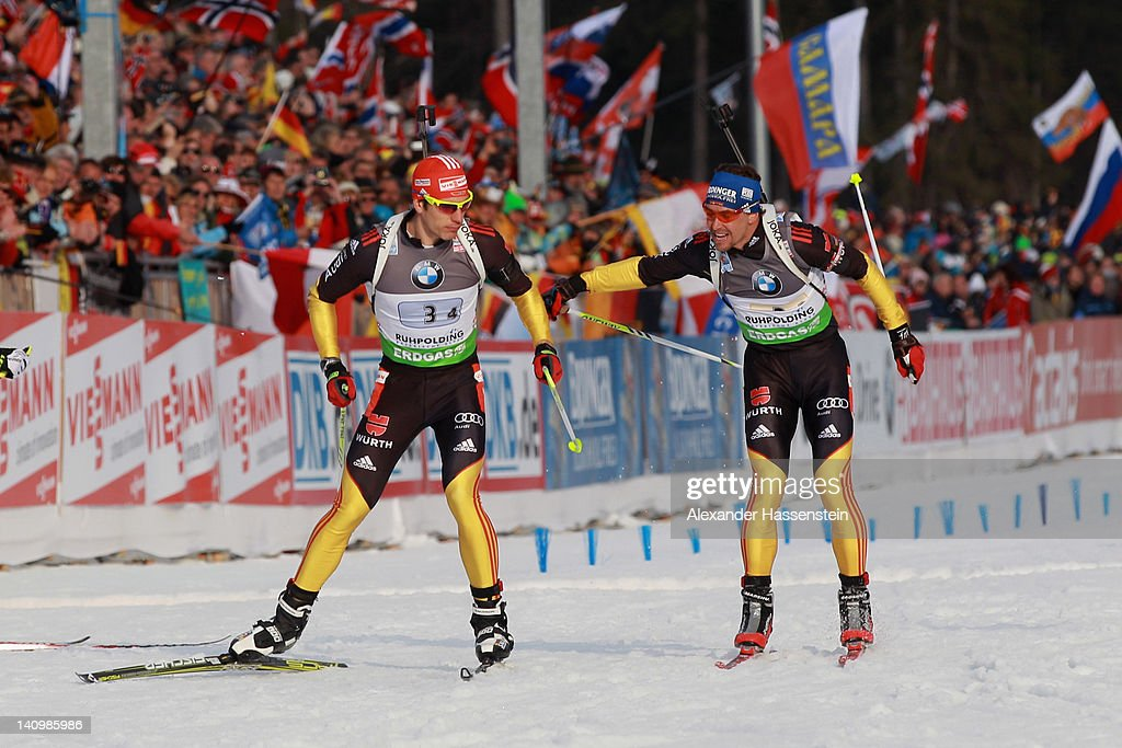 Michael Greis (R) of team Germany hands over to his team mate Arnd Peiffer during the Men's 4 x 7.5km Relay during the IBU Biathlon World Championships at Chiemgau Arena on March 9, 2012 in Ruhpolding, Germany.