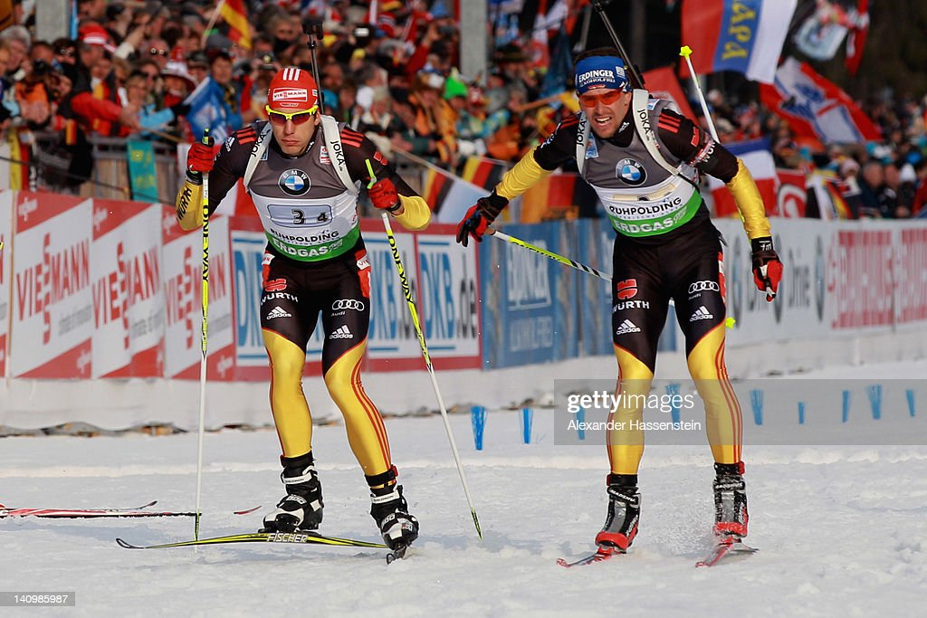Michael Greis of team Germany hands over to his team mate Arnd Peiffer during the Men's 4 x 75km Relay during the IBU Biathlon World Championships at...