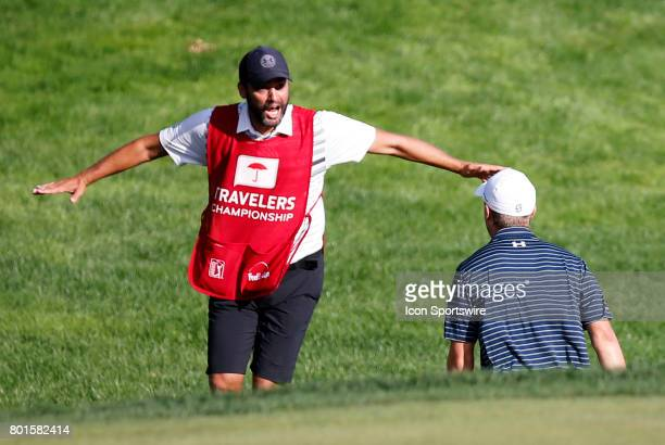 Michael Greller caddie for Jordan Spieth of the United States reacts to the miracle bunker shot to win the Travelers Championship on June 25 at TPC...