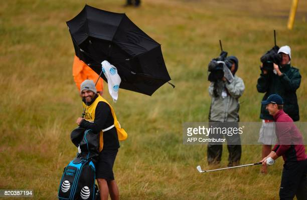 Michael Greller US golfer Jordan Spieth's caddie battle with the wind on day two of the Open Golf Championship at Royal Birkdale golf course near...