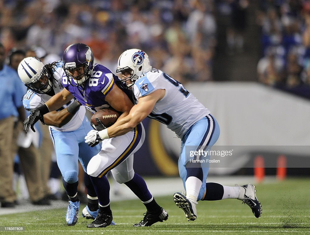 Michael Griffin #33 and Scott Solomon #90 of the Tennessee Titans tackle Chase Ford #86 of the Minnesota Vikings during the second quarter of the game on August 29, 2013 at Mall of America Field at the Hubert H. Humphrey Metrodome in Minneapolis, Minnesota.