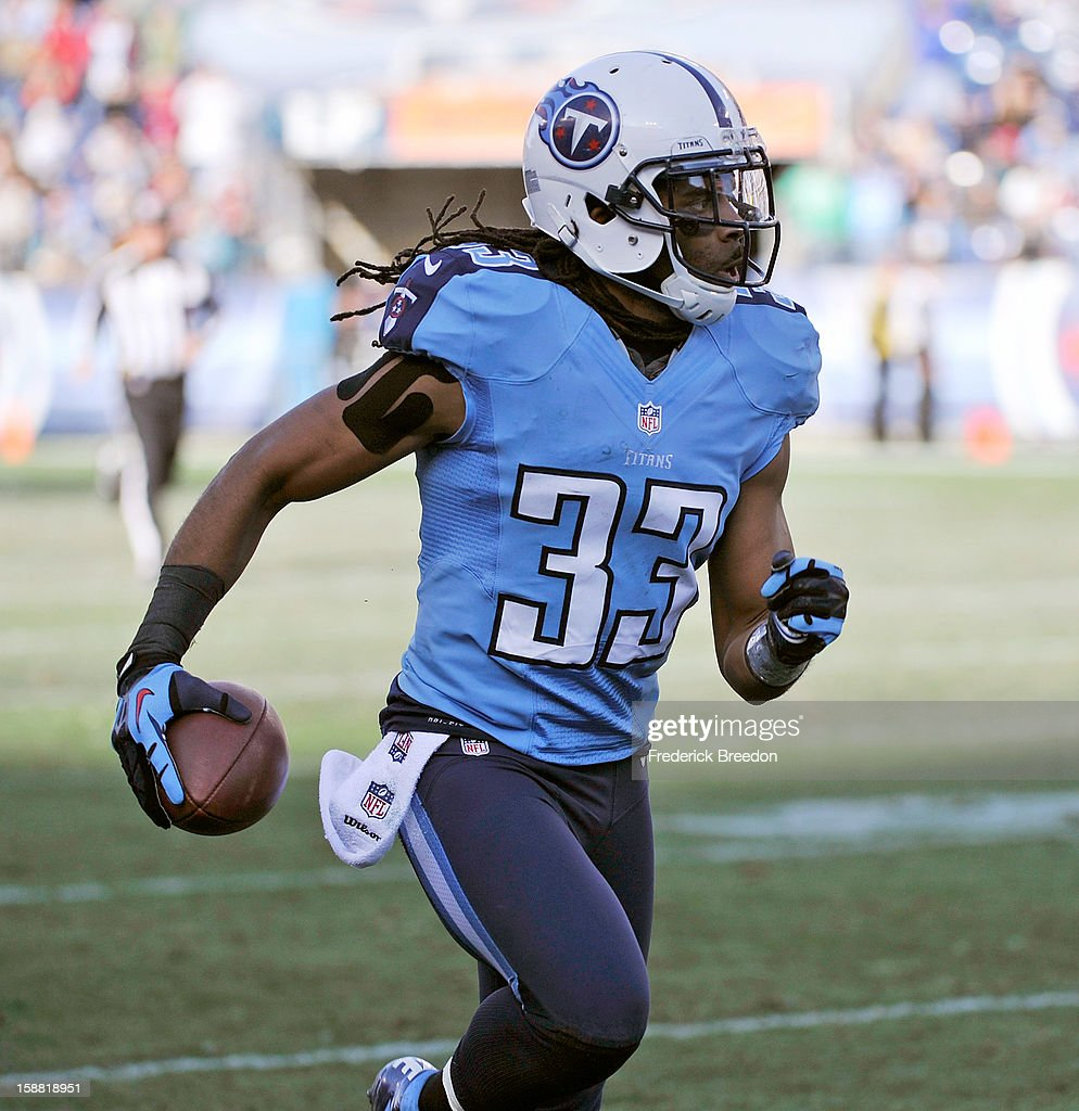Michael Griffin #33 of the Tennessee Titans carries the ball after making an interception against the Jacksonville Jaguars at LP Field on December 30, 2012 in Nashville, Tennessee.
