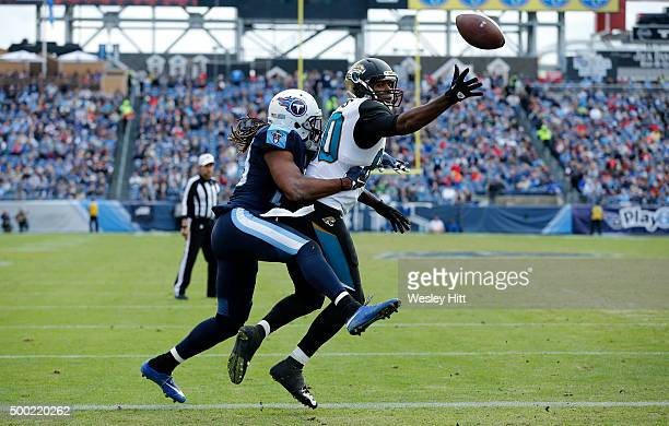 Michael Griffin of the Tennessee Titans defends against Julius Thomas of the Jacksonville Jaguars during the game at Nissan Stadium on December 6...