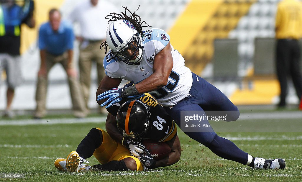 Michael Griffin #33 of the Tennessee Titans hits Antonio Brown #84 of the Pittsburgh Steelers in the second half during the game on September 8, 2013 at Heinz Field in Pittsburgh, Pennsylvania. The Titans defeated the Steelers 16-9.