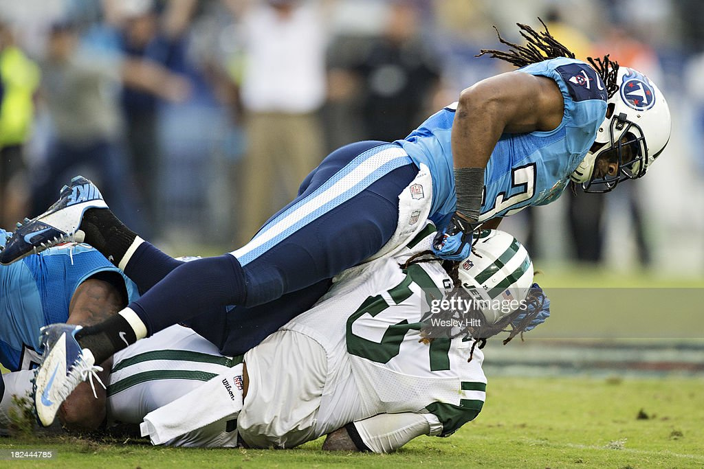 Michael Griffin #33 of the Tennessee Titans tackles <a gi-track='captionPersonalityLinkClicked' href=/galleries/search?phrase=Alex+Green&family=editorial&specificpeople=6683075 ng-click='$event.stopPropagation()'>Alex Green</a> #25 of the New York Jets at LP Field on September 29, 2013 in Nashville, Tennessee. The Titans defeated the Jets 38-13.