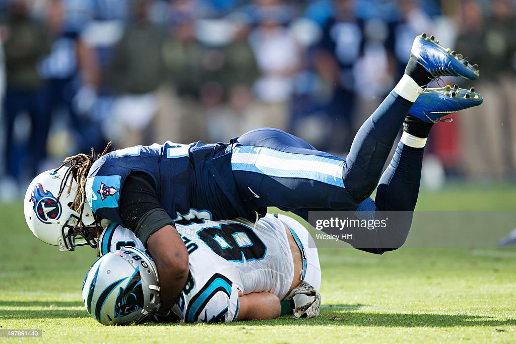 Michael Griffin #33 of the Tennessee Titans tackles Greg Olsen #88 of the Carolina Panthers at Nissan Stadium on November 15, 2015 in Nashville, Tennessee.