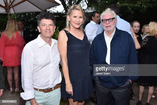 Michael Gross Patricia Duff and Richard Cohen attend AVENUE on the Beach's Summer Soiree at The Baker House on August 12 2017 in East Hampton New York