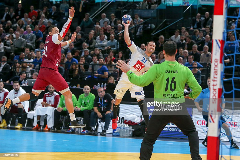 <a gi-track='captionPersonalityLinkClicked' href=/galleries/search?phrase=Michael+Guigou&family=editorial&specificpeople=791016 ng-click='$event.stopPropagation()'>Michael Guigou</a> #21 of France shoots the ball against <a gi-track='captionPersonalityLinkClicked' href=/galleries/search?phrase=Goran+Stojanovic&family=editorial&specificpeople=605266 ng-click='$event.stopPropagation()'>Goran Stojanovic</a> #16 of Qatar during the Golden League game between France and Qatar at Accord Hotels Arena on January 9, 2016 in Paris, France.