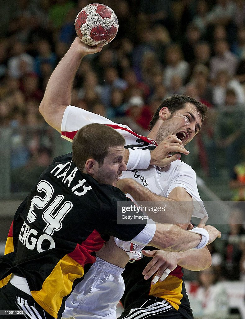 Michael Haas of Germany is challenged by Bernd Friede of Austria during the Euro 2012 qualifier match between Austria and Germany at Olympiahalle on June 8, 2011 in Innsbruck, Austria.