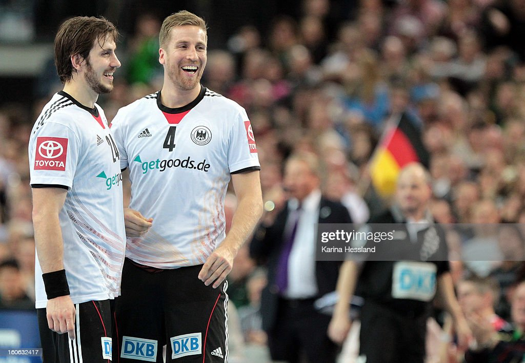Michael Haass and Oliver Roggisch of Germany happy during the match between Germany and Bundesliga All Stars on February 2, 2013 in Leipzig, Germany.