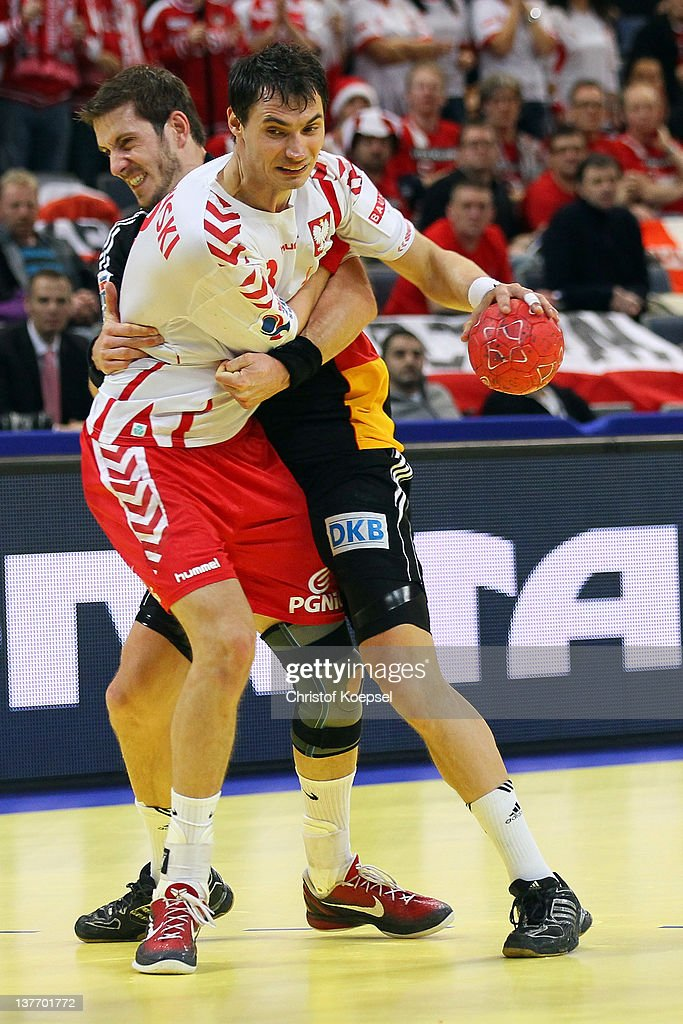 Michael Haass of Germany (R) defends against Krzysztof Lijewski of Poland (L) during the Men's European Handball Championship second round group one match between Poland and Germany at Beogradska Arena on January 25, 2012 in Belgrade, Serbia.