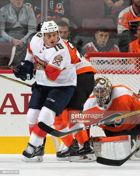 Michael Haley of the Florida Panthers screens Brandon Manning and Michal Neuvirth of the Philadelphia Flyers on October 17 2017 at the Wells Fargo...