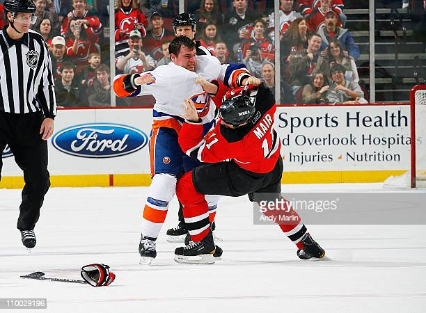 Michael Haley of the New York Islanders and Adam Mair of the New Jersey Devils fight during the first period during the game at the Prudential Center...