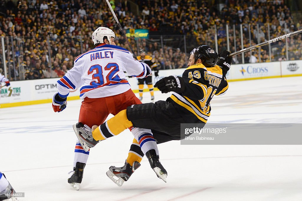 Michael Haley #32 of the New York Rangers checks Matt Bartowski #43 of the Boston Bruins in Game Five of the Eastern Conference Semifinals during the 2013 NHL Stanley Cup Playoffs at TD Garden on May 25, 2013 in Boston, Massachusetts.