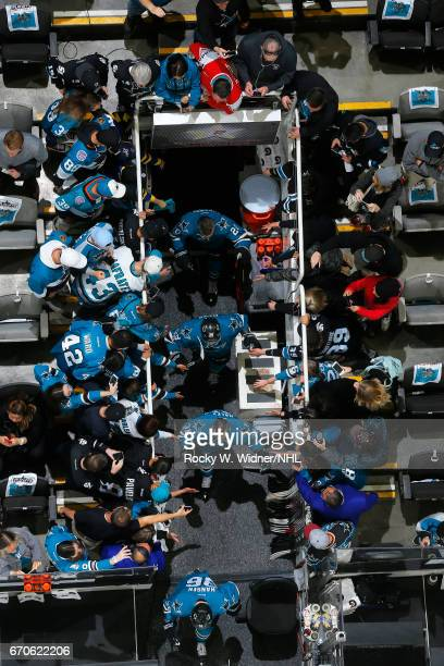Michael Haley Timo Meier and Marcus Sorensen of the San Jose Sharks greet fans while exiting from the tunnel prior to the game against the Edmonton...