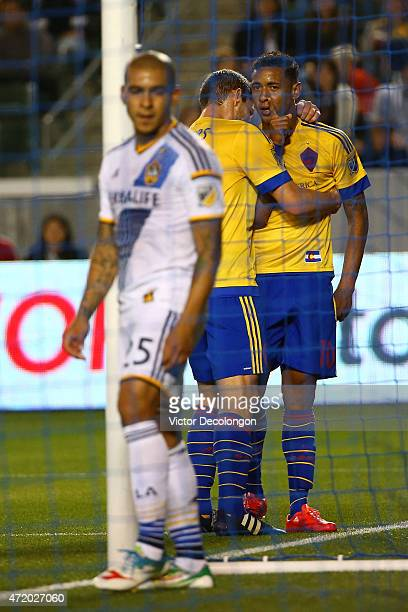Michael Harrington and Gabriel Torres of Colorado Rapids celebrate after Torres scored as Rafael Garcia of Los Angeles Galaxy looks on in the first...