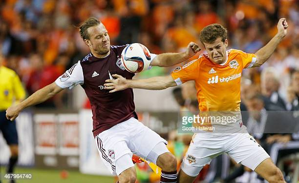 Michael Harrington of the Colorado Rapids battles for the ball with Rob Lovejoy of the Houston Dynamo during their game at BBVA Compass Stadium on...