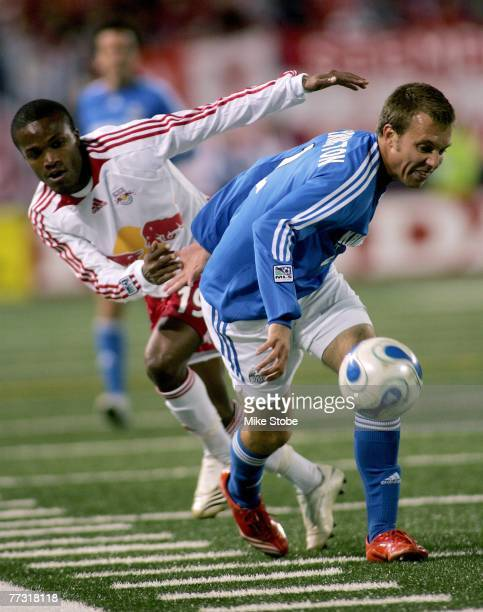 Michael Harrington of the Kansas City Wizards and Dane Richards of the New York Red Bulls chase the ball during their match at Giants Stadium in the...
