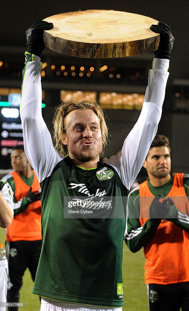 Michael Harrington #5 of the Portland Timbers holds up a Timber slab after scoring a goal in the game against AIK at Jeld-Wen Field on February 23, 2013 in Portland, Oregon. The game ended in a 1-1 draw.