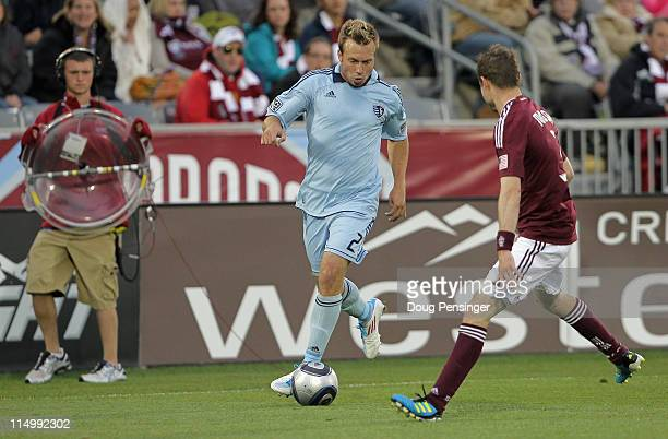 Michael Harrington of the Sporting KC controls the ball against Drew Moor of the Colorado Rapids at Dick's Sporting Goods Park on May 28 2011 in...