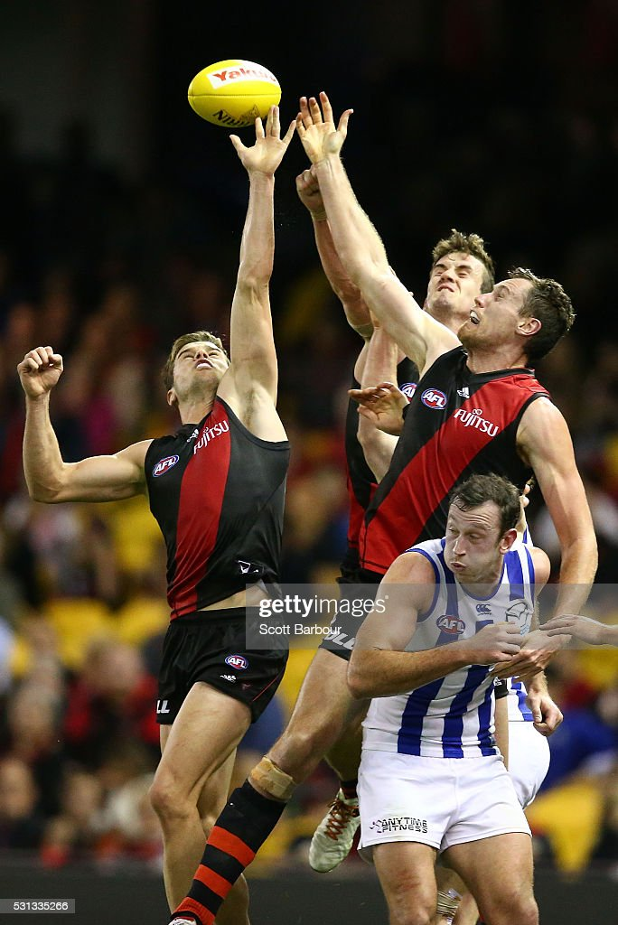 Michael Hartley and Matthew Leuenberger of the Bombers compete for the ball as Todd Goldstein of the Kangaroos looks on during the round eight AFL match between the Essendon Bombers and the North Melbourne Kangaroos at Etihad Stadium on May 14, 2016 in Melbourne, Australia.